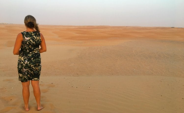 Image of woman looking into the desert