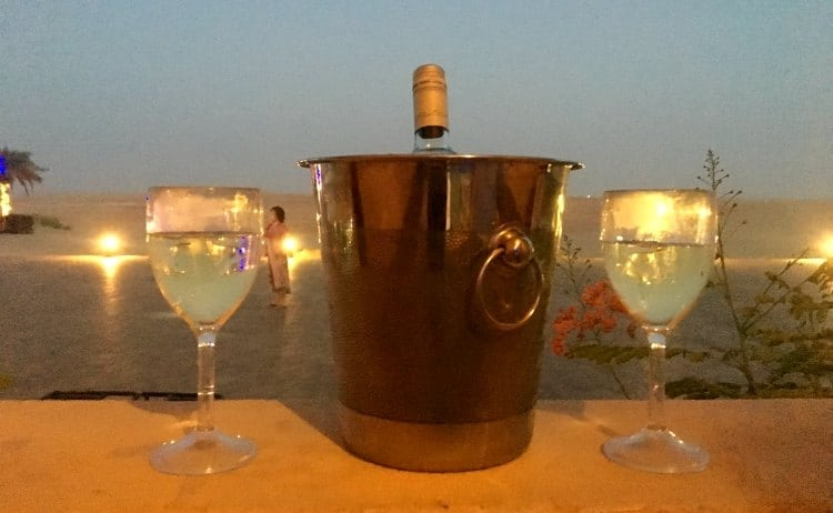 Wine glasses at sunset at Tilal Liwa Resort, Abu Dhabi