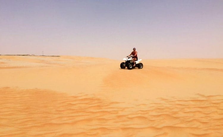 Image of woman on quad bike in the desert