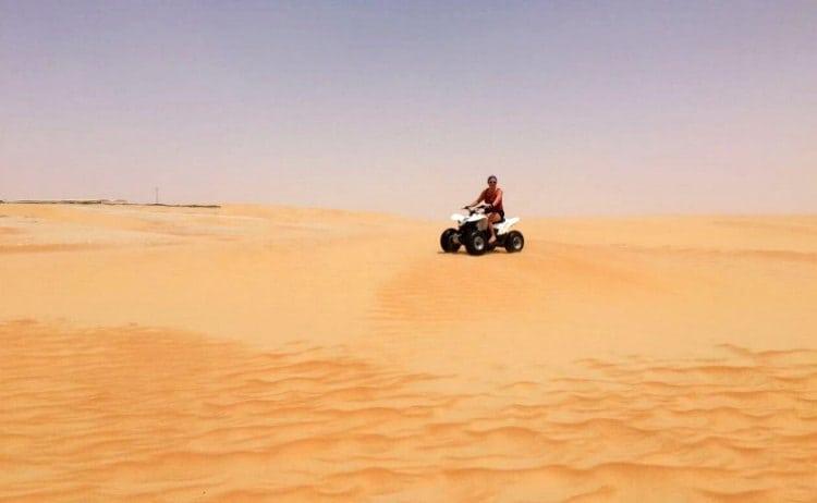 Quad bike in the desert by Tilal Liwa Resort