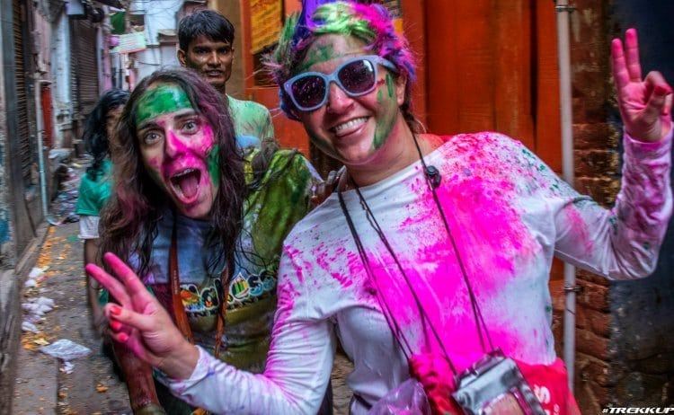 Image of two women in bright paint at holi festival