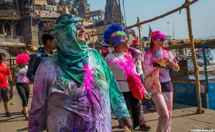 Image of two women in bright paint in india
