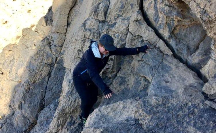 Image of woman climbing rocks