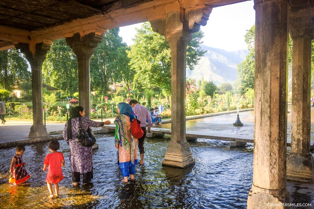 Play in the fountains at Shalimar Bagh Gardens in Srinagar