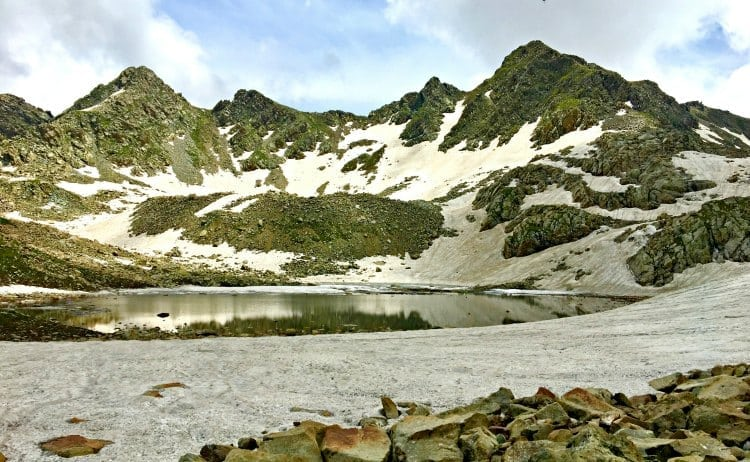 Image of snow by an alpine lake