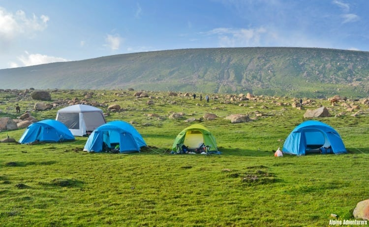 Image of tents in green mountains