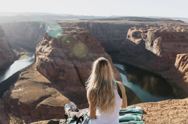 Image of woman sat overlooking rocky mountains