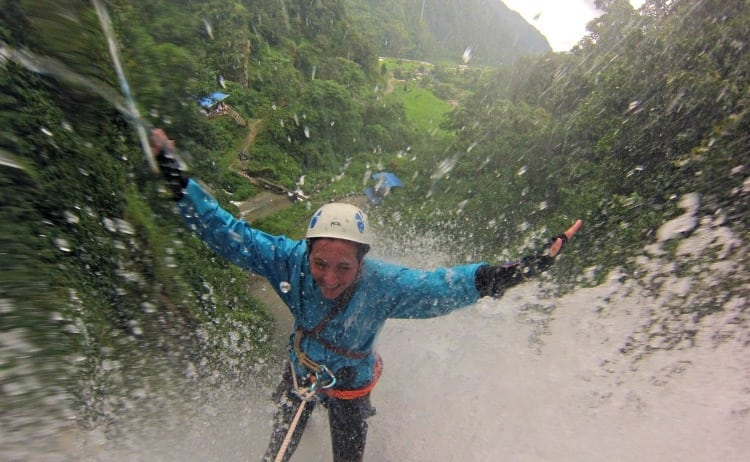 woman abseiling down 45m waterfall in nepal