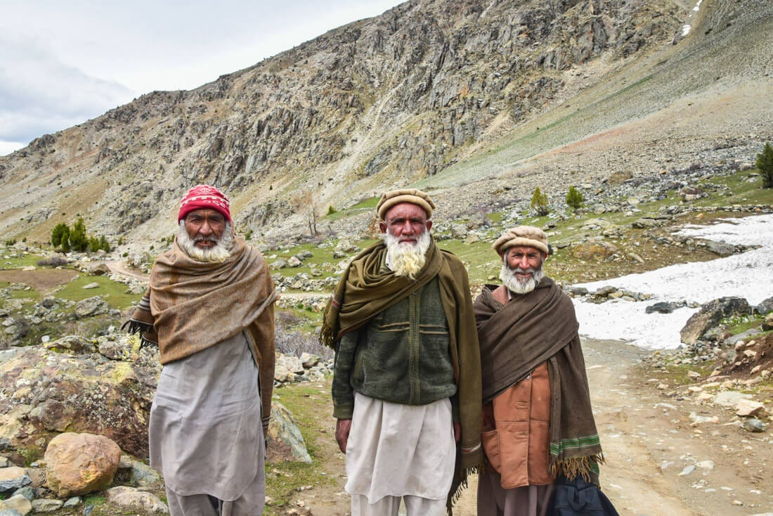 Joan Torres, Against the Compass, with Pakistani men in the mountains