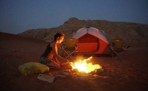 Making campfire by Fossil Rock in sharjah