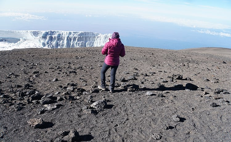 Day 4 on the Kilimanjaro trek. Wanders Miles looking out to the glacier at Uhuru Peak, the roof of Africa.