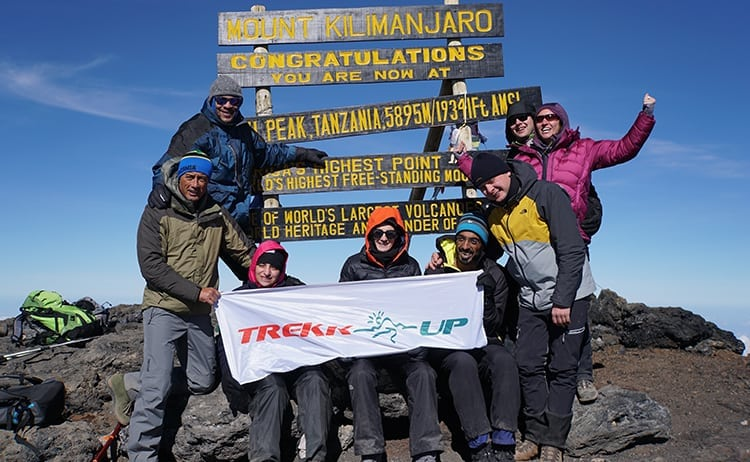 Day 4 on the Kilimanjaro trek. Wanders Miles with the Trekkup group at Uhuru Peak.