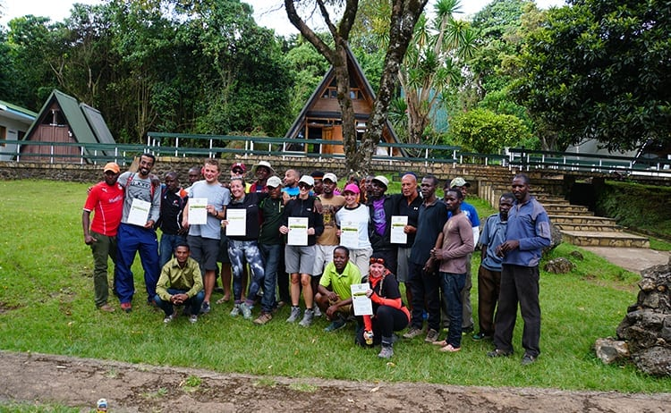 Day 5 on the Kilimanjaro trek. Present our Kilimanjaro certificates at Marangu Gate.