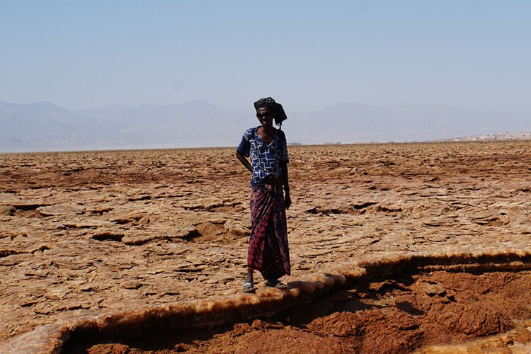 Afar man by sulphuric acid pool in the Danakil Depression