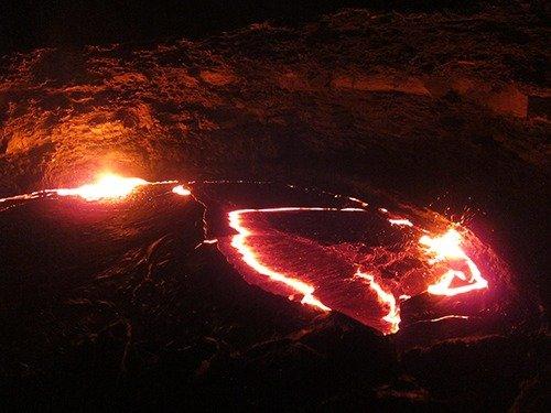Live lava at night at Erta Ale volcano in the Danakil Depression