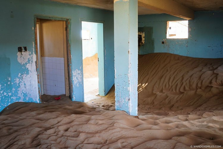 House in Al Madam filled with sand dunes