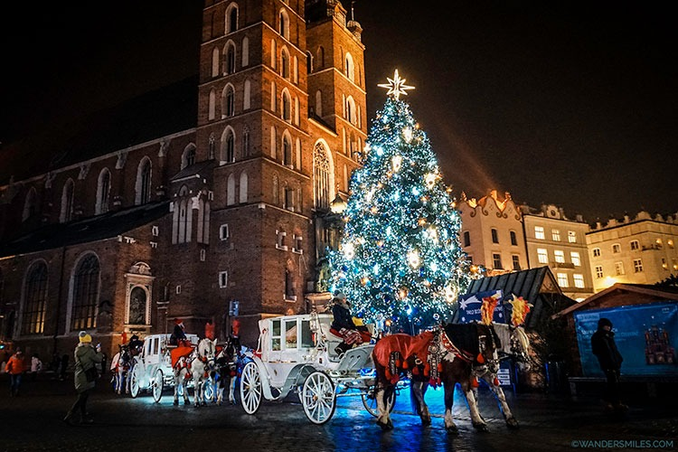 Christmas tree and horse and cart in front of St Marys Basilica in the Main Square, Krakow