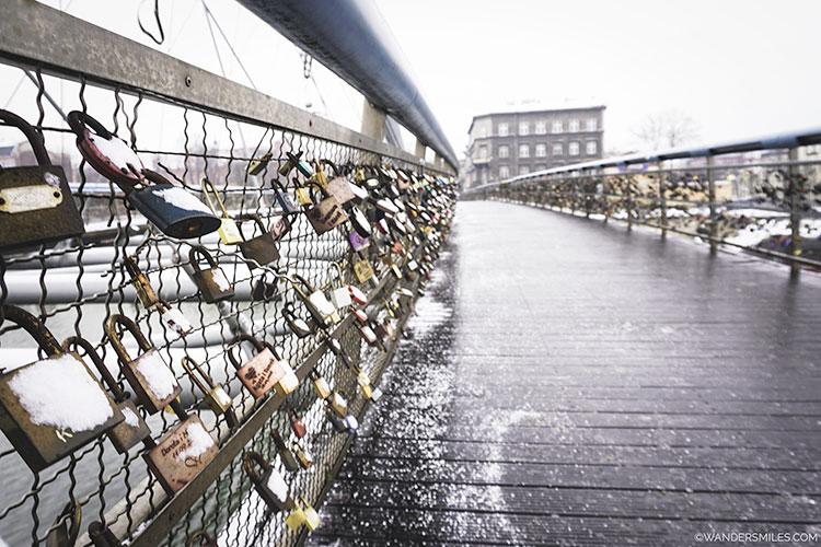 Locks on Lovers Bridge over Vistula River in Krakow