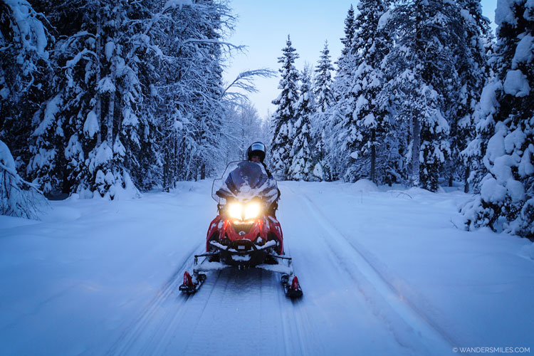 Snowmobiling in the Arctic wilderness of Finnish Lapland
