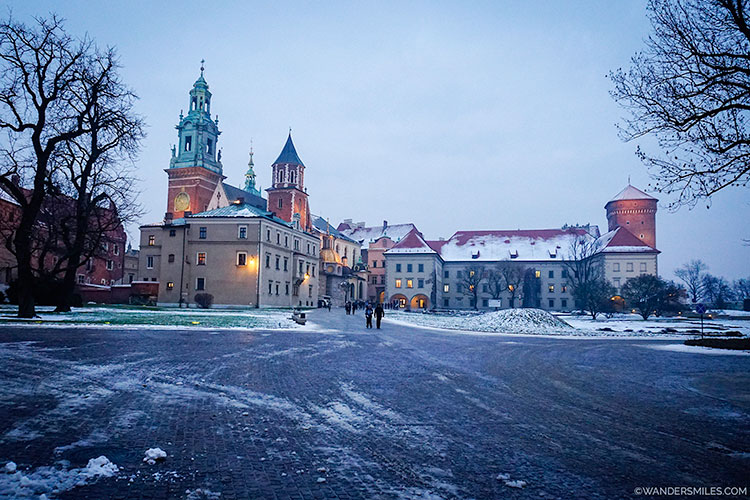 Snowy courtyard at Wawel Castle showing Wawel Cathedral
