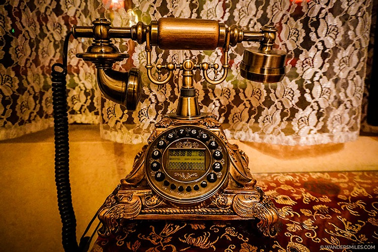 Vintage phone in the bedroom at Beijing Double Happiness Courtyard Hotel