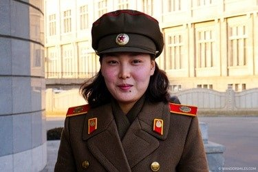 North Korean guide dressed in military uniform at the Victorious Fatherland War Museum - Things to see in Pyongyang