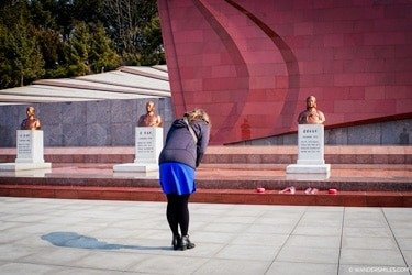 Bowing to the grave of Kim Jong Suk at the Taesongsan Revolutionary Martyrs' Cemetary, Pyongyang - Things to see in Pyongyang