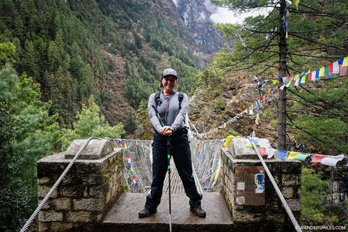 Vanessa from Wanders Miles by the big suspension bridge on Everest Base Camp Trail