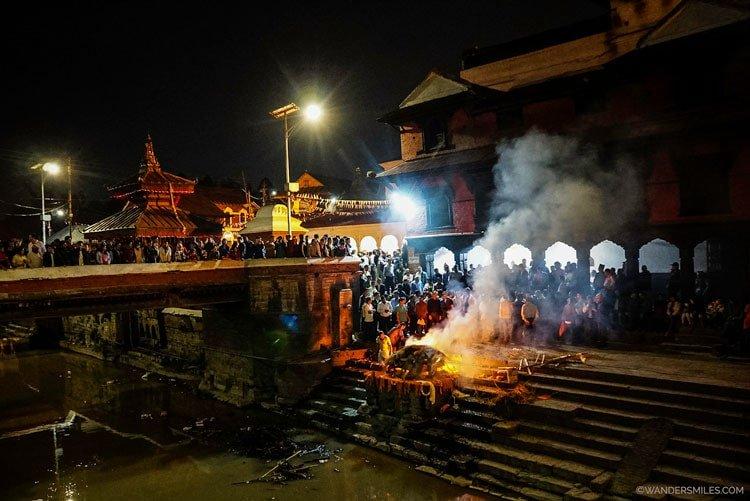 Cremations at Pashupatinath Temple at dusk in Kathmandu, Nepal