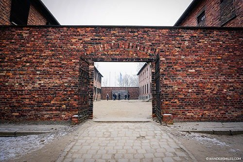 The entrance to the courtyard containing the Death Wall at Auschwitz, Poland.