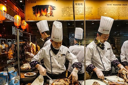 Peking Duck ebing prepared at Huas Restaurant in Beijing
