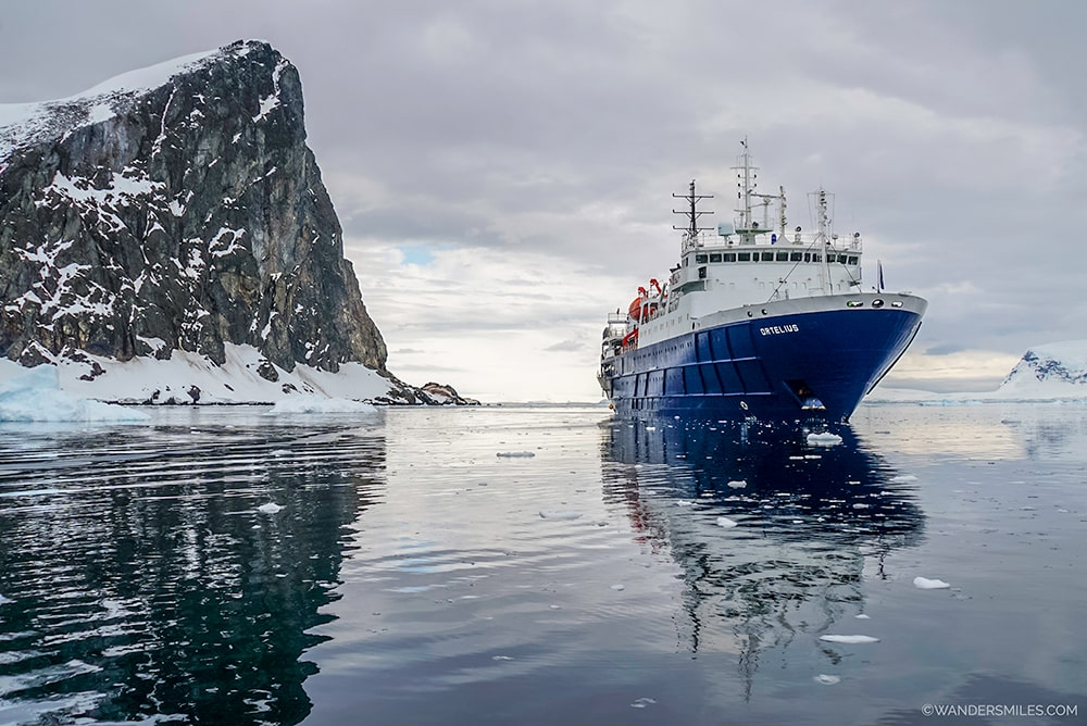 Ortelius ship by Spigot's Peak in Orne Harbour, Antarctica