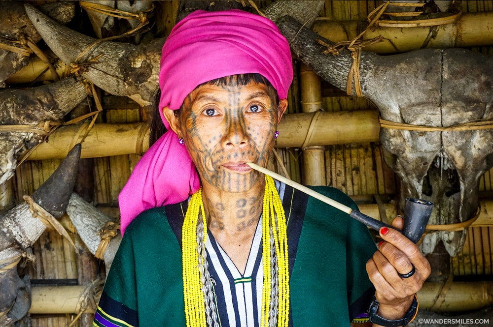 Beautiful face-tattooed women from Muun Tribe in Nat Ma Taung National Park
