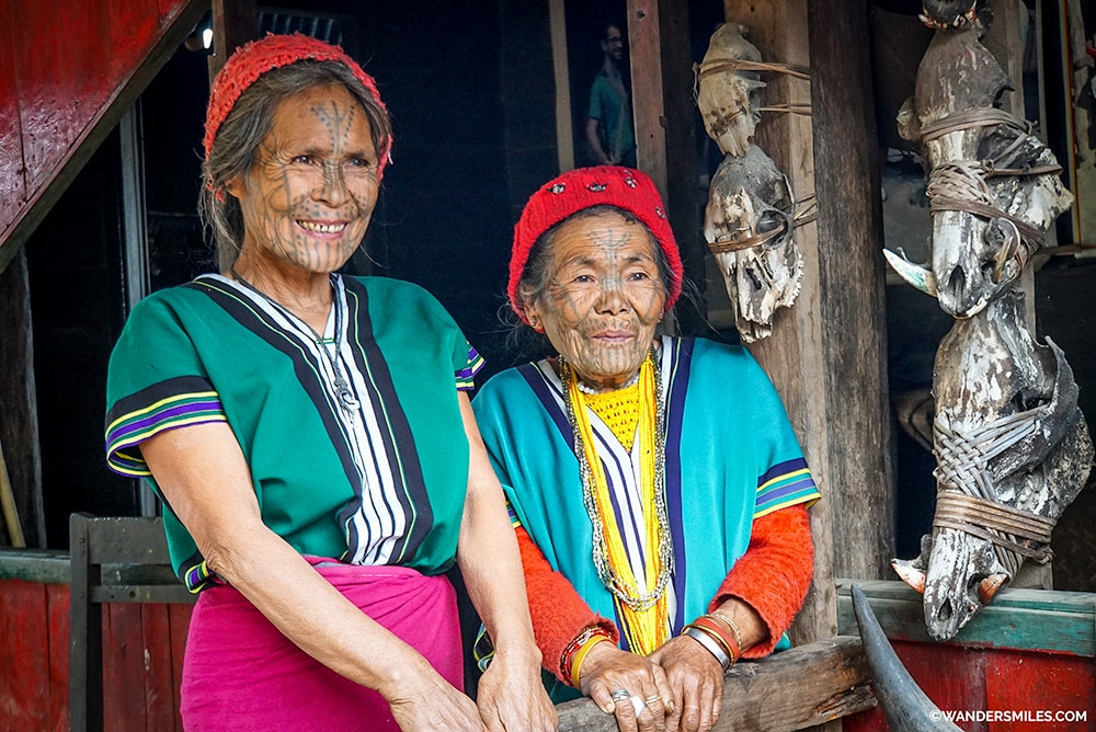 Face-tattooed women smiling women Muun Tribe on Mt Victoria in Myanmar