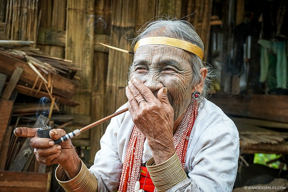 Face tattooed woman laughing from Yindu Tribe, Myanmar