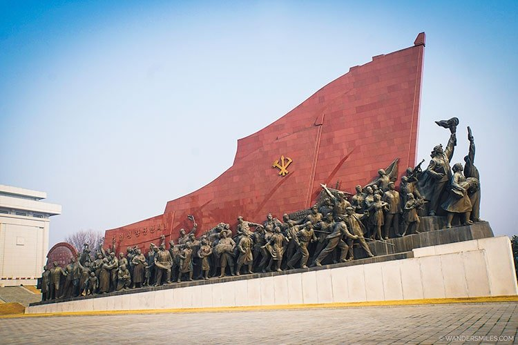 KWP flags and 228 bronze figures at the Mansu Hill Grand Monument - Things to see in Pyongyang