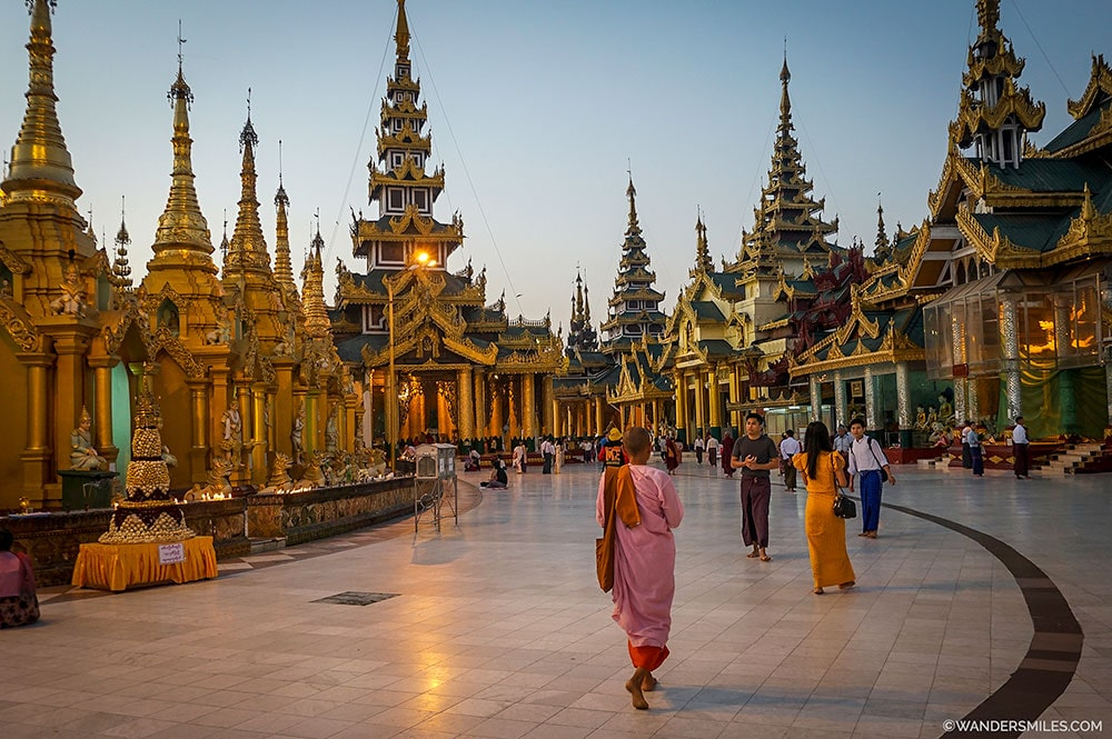Female monks walking round the at Swedagon Pagoda at sunrise in Yangon