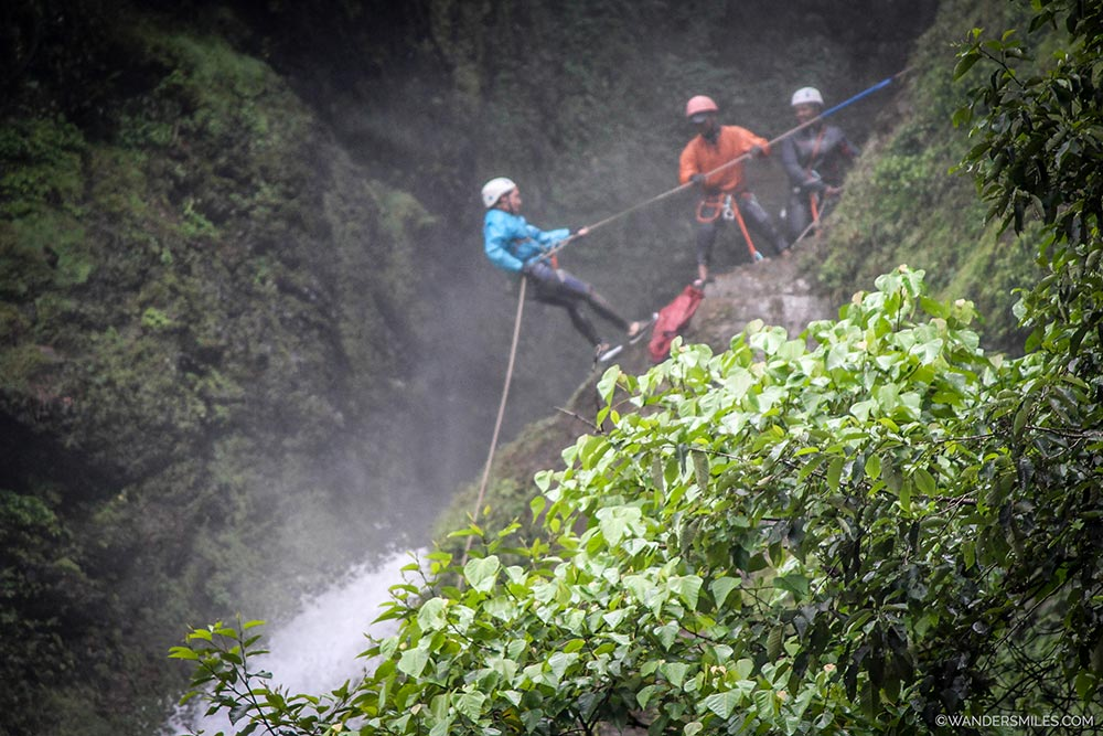 Over the top to start rappelling down 45m waterfall - Nepal - Wanders Miles