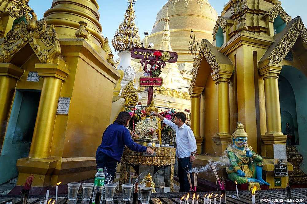 Pouring water over the Buddha at Saturday Corner, Shwedagon Pagoda