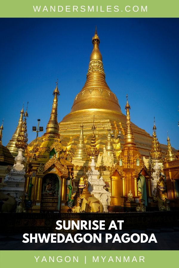 Blues skies contrast against the shimmering golden stupa of Yangon's Shwedagon Pagoda at sunrise
