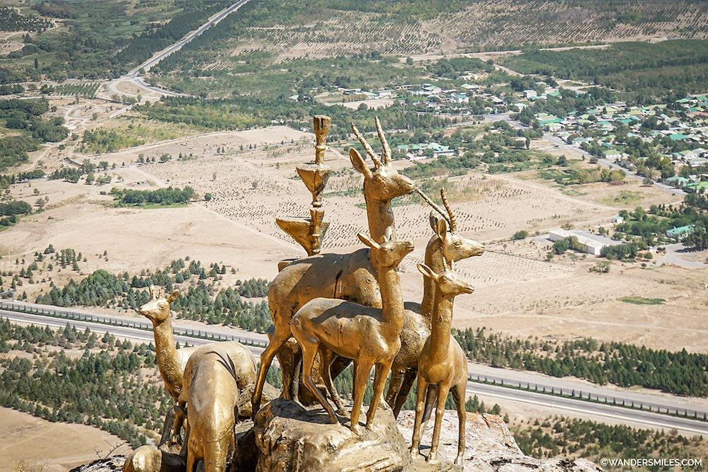 Gold statues on the Walk of Health, Kopet Dag mountains by Ashgabat, Turkmenistan. © Wanders Miles