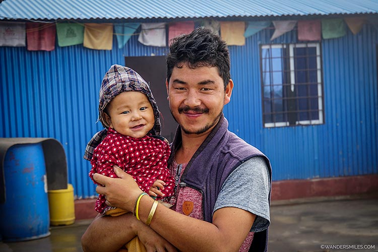 Tamang father with his baby on Tonchuk Mountain, Kathmandu Valley in Nepal