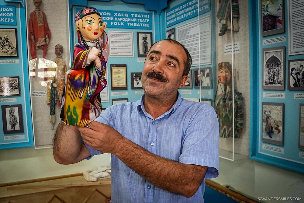 Iskandar Khakimov, the owner of History of Bukhara Puppet Theatre gives a demo