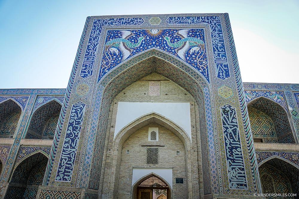 Ornate mosaics on the exterior of Lyabi Khauz Palace in Bukhara, Uzbekistan