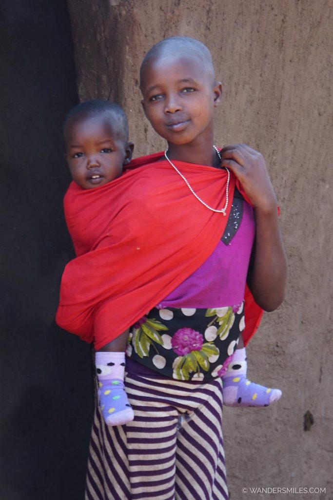 Maasai tribal woman with a baby on her back
