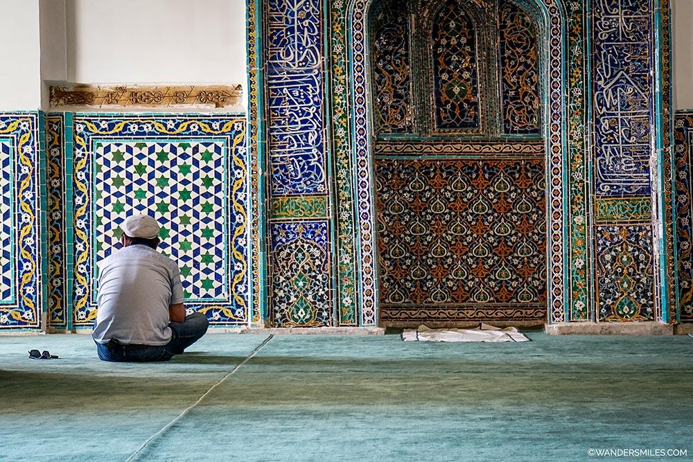 Man praying at the Shah-i-Zinda Necropolis - Exploring Samarkand