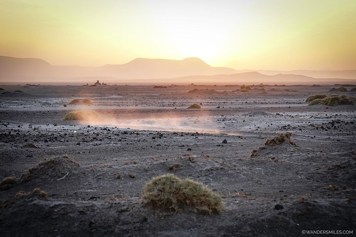 natural chimneys and hot springs at sunset by Lake Abbe in Djibouti