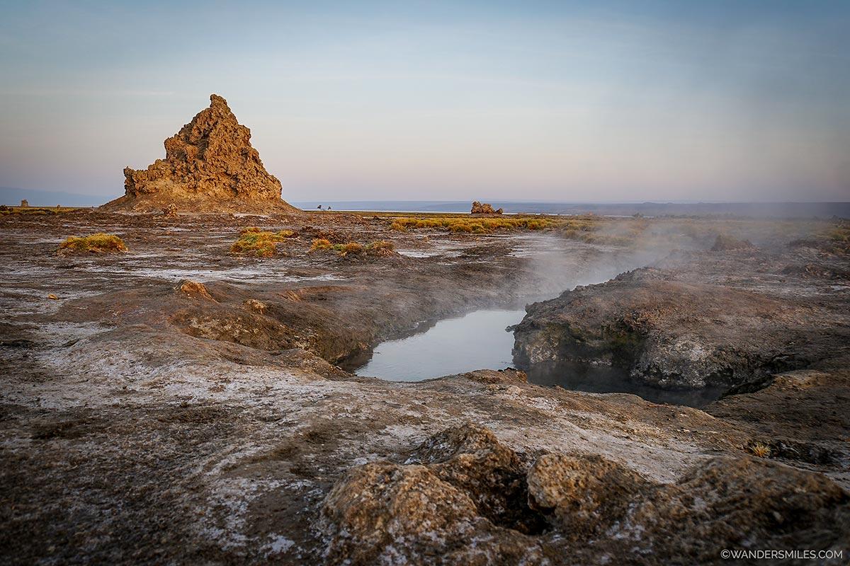 Steaming hot springs at sunrise by the chimneys at Lake Abbe, Djibouti