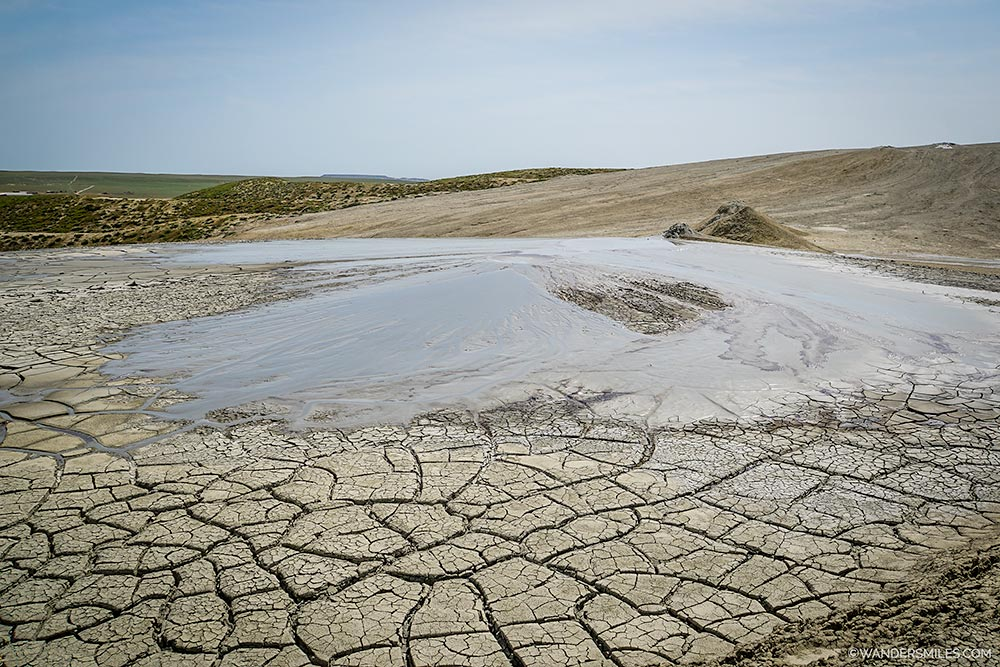 Cracked mud and overflowing mud volcanoes in Gobustan Nature Reserve, Azerbaijan