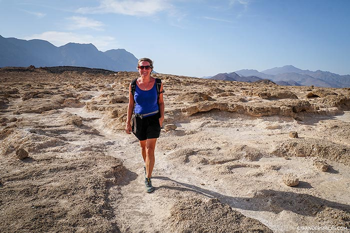Hiking on the volcanic landscape before descending to Lake Assal in Djibouti, East Africa